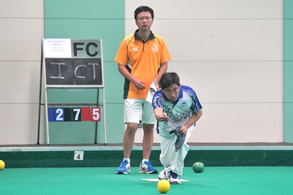 Hong Kong Football Club bowler CT Wong (delivering) on the way to defeating Imen Tang from Craigengower Cricket Club to win his first National Indoor Singles trophy last Saturday, July 15, 2017. The match is\was also the last game the green hosted before being closed for refurbishment. (Mike Worth)