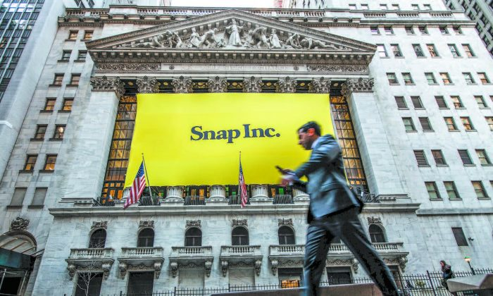 Signage for Snap Inc., parent company of Snapchat, on the front of the New York Stock Exchange on March 2. (DREW ANGERER/GETTY IMAGES)