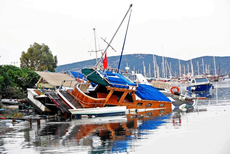 Damaged boats are seen after an earthquake and a tsunami in the resort town of Gumbet in Mugla province, Turkey, July 21, 2017. Yasar Anter/Dogan News Agency via REUTERS