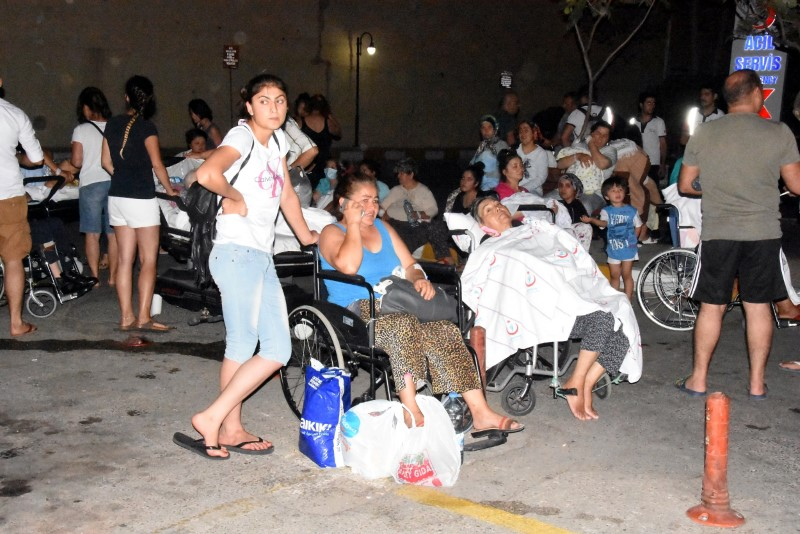 People wait in front of a hospital after an earthquake in the resort town of Bodrum in Mugla province, Turkey, July 21, 2017. Dogan News Agency via REUTERS