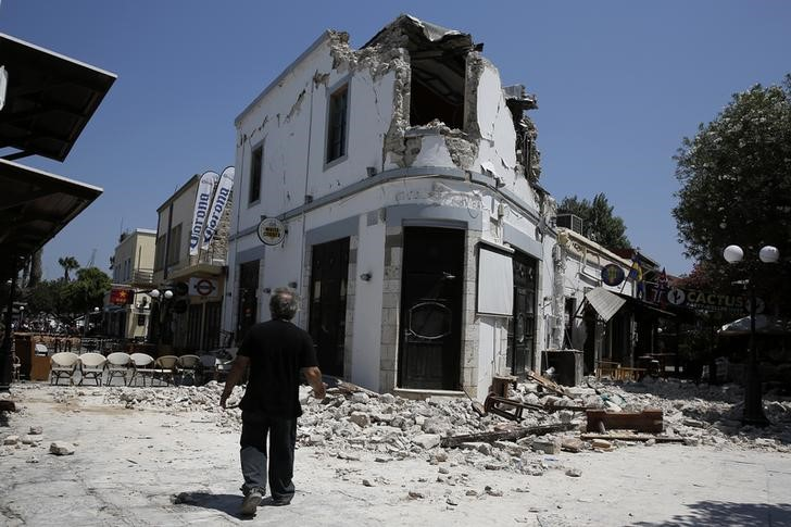A man stands in front of a damaged building following an earthquake off the island of Kos, Greece on July 21, 2017. (REUTERS/Costas Baltas)