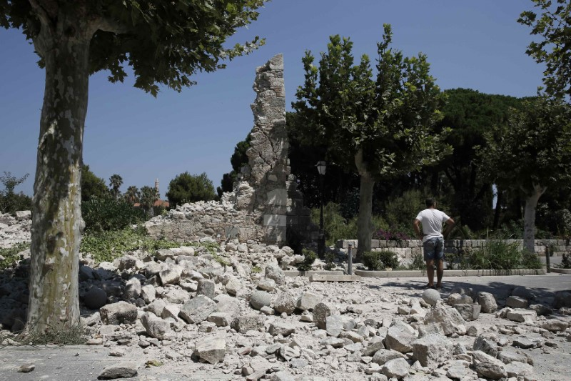 A man stands next to debris following an earthquake on the island of Kos, Greece on July 21, 2017. (REUTERS/Costas Baltas)