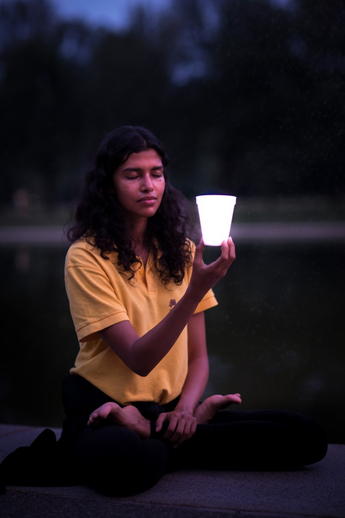 Pooja Mor joins Falun Gong practitioners during a candlelight vigil around the Lincoln Memorial Reflecting Pool in Washington on July 20, 2017, to honor those who have died during the persecution in China that the Chinese regime started on July 20, 1999. (Benjamin Chasteen/The Epoch Times)