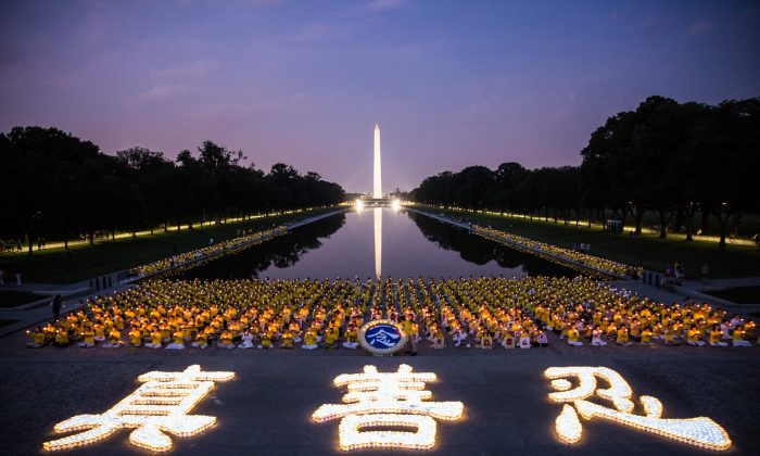 Hundreds of Falun Dafa practitioners hold a candlelight vigil in Washington on July 20, 2017 to remember the victims of the Chinese regime's persecution of the practice that began on July 20, 1999. The candles in the front form the Chinese characters for truthfulness, compassion, and tolerance, the three main tenets of Falun Dafa. (Benjamin Chasteen/The Epoch Times)
