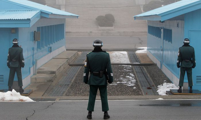 South Korean soldiers stand guard at the border village of Panmunjom between South and North Korea at the Demilitarized Zone (DMZ) on February 27, 2013 in South Korea.  (Photo by Chung Sung-Jun/Getty Images)