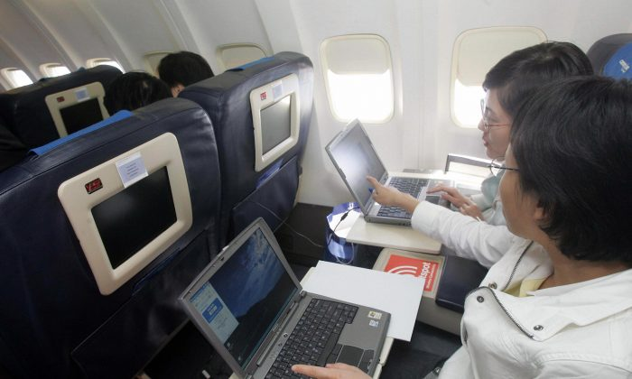 Guests try out the wireless connection to the Internet on their laptops (STR/AFP/Getty Images)