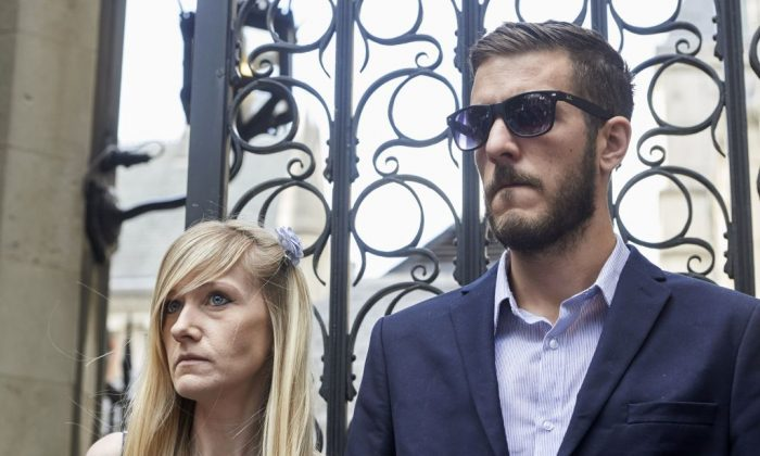 The parents of terminally-ill, 10-month-old Charlie Gard, Chris Gard and Connie Yates stand by as a spokesperson delivers a statement to the media outside the High Court in London on July 10, 2017. (NIKLAS HALLEN/AFP/Getty Images)