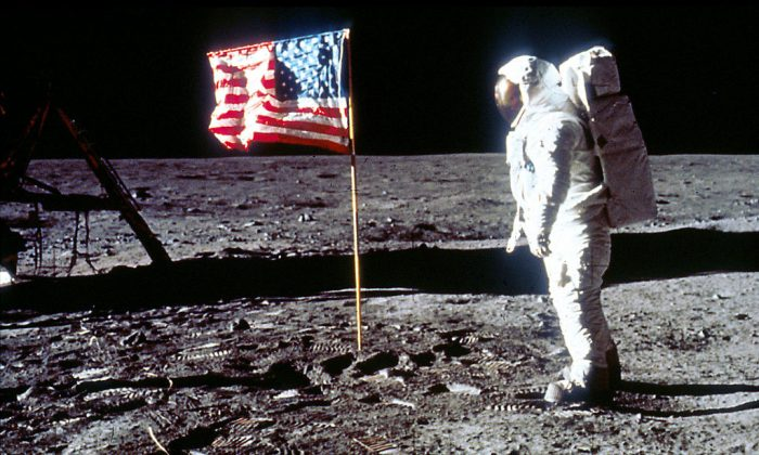 "Astronaut Edwin ""Buzz"" Aldrin poses next to the U.S. flag July 20, 1969 on the moon during the Apollo 11 mission. (Photo by NASA/Liaison)"