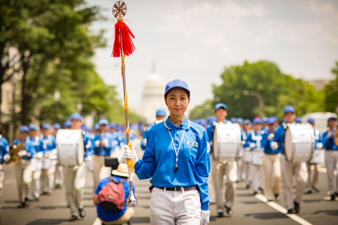 Hundreds of Falun Gong practitioners march in a parade in Washington D.C. on July 20, 2017. The parade is calling for an end to a brutal persecution in China that started on July 20, 1999. (Larry Dye/The Epoch Times)