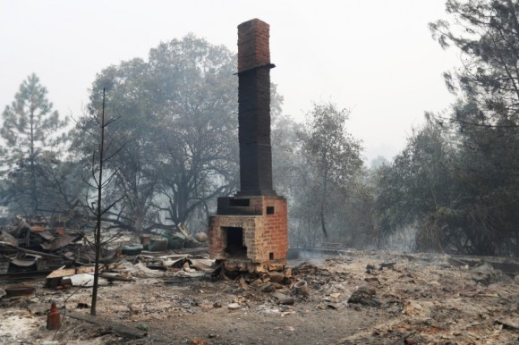 A chimney stands amidst remains of a home destroyed by the Detwiler fire in Mariposa, California. (Reuters/Stephen Lam)