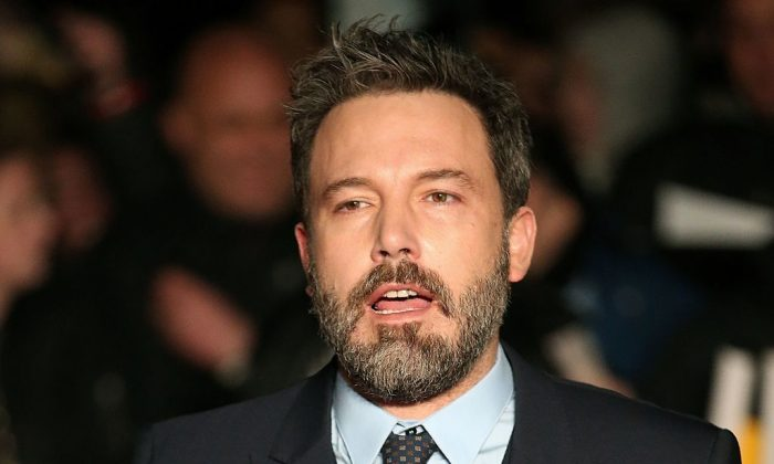 """US actor Ben Affleck poses upon arrival at the European Premiere of the film """"Live By Night"""" in London, on January 11, 2017. (DANIEL LEAL-OLIVAS/AFP/Getty Images)"""