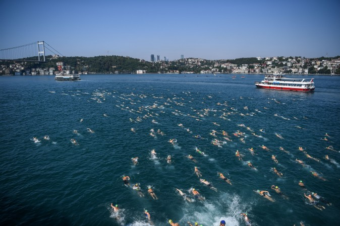 Swimmers compete in the Bosphorous river as they take part in the Bosphorus Cross Continental Swim event on July 23, 2017. The race takes participants 6 kms down the Bosphorus Strait from the Asian side of Istanbul to the European side. (OZAN KOSE/AFP/Getty Images)
