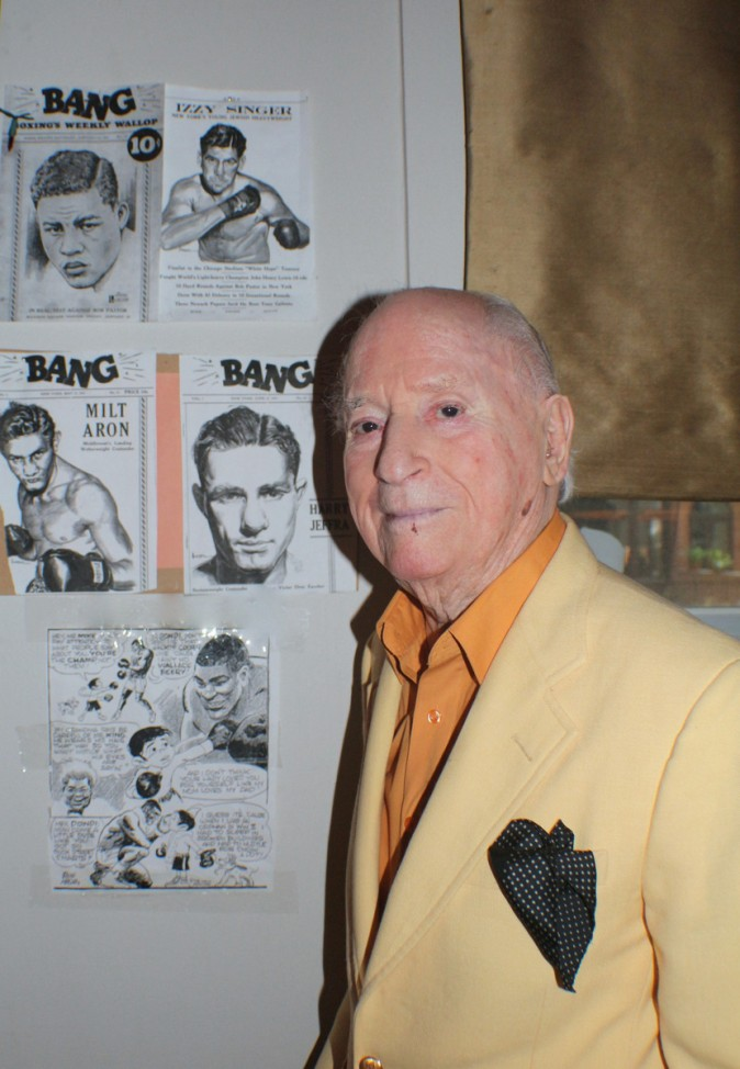 Irwin Hasen poses with some of the covers he drew of famous prize fighters for Bang Magazine. (Myriam Moran copyright 2014)