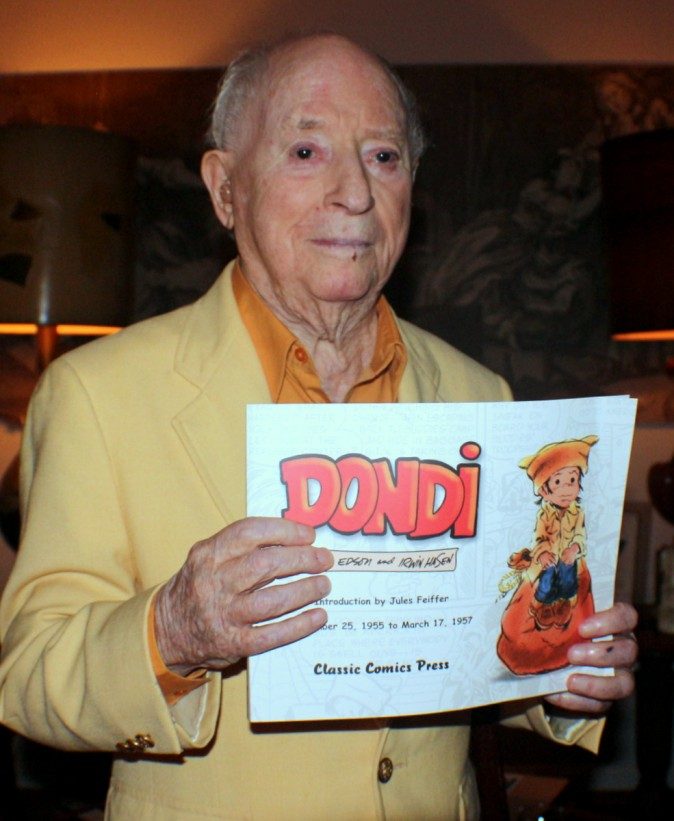 Irwin Hasen with his book, one of two volumes, published about the Dondi strip that ran for 34 years in newspapers across America. (Myriam Moran copyright 2014)