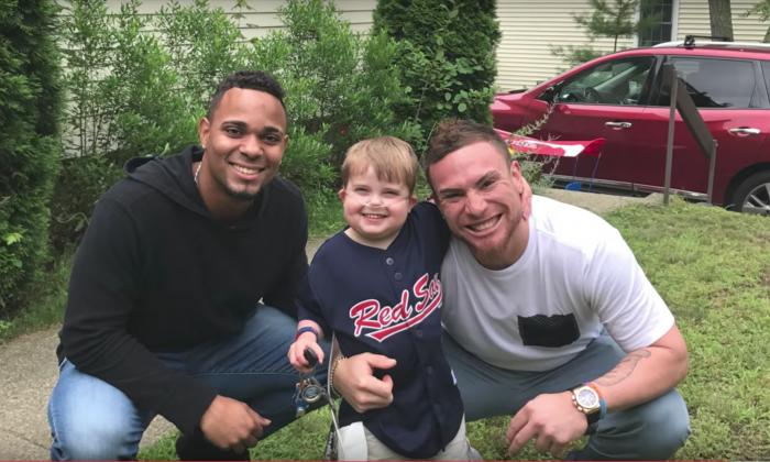 "shortstop Xander Bogaerts,  Ari Schultz, and  Red Sox catcher Christian Vazquez.  (Screenshot of Youtube video titled ""Ari 1 Month Home, and Big News!"")"