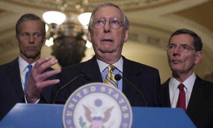 Senate Majority Leader Mitch McConnell (C), (R-Ky), speaks about the Senate Republican's healthcare bill alongside Senator John Thune (L), (R-SD), and Senator John Barrasso (R), (R-Wy), at the US Capitol in Washington, DC, June 27, 2017. (Saul Loeb/AFP/Getty Images)