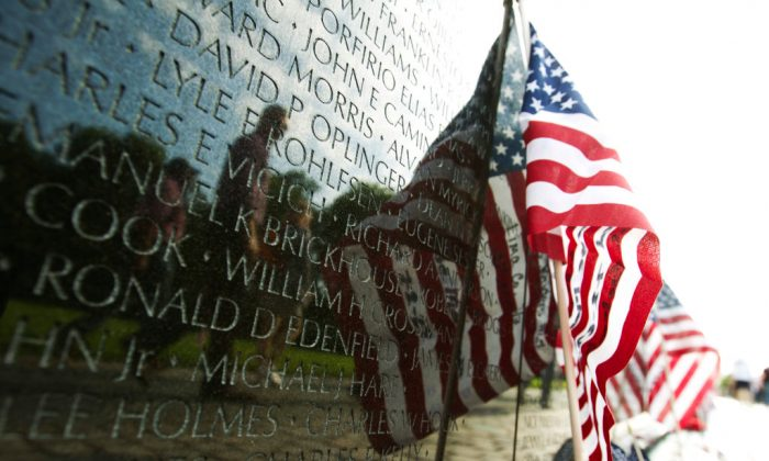 A US flag adorns the wall of the Vietnam Veterans Memorial in Washington DC, May 28, 2017.  (JOSE LUIS MAGANA/AFP/Getty Images)