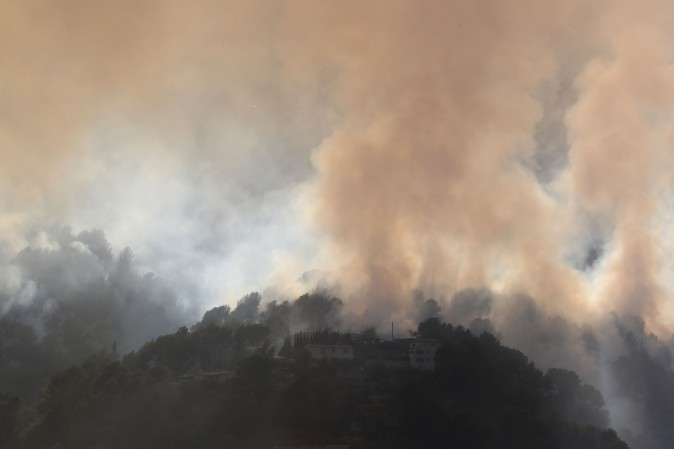 Smoke from a fire billows over Carros, southeastern France, on July 24, 2017. (VALERY HACHE/AFP/Getty Images)
