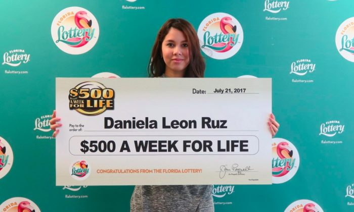"Daniela Leon Ruz, 18, claims her prize after winning Florida Lottery's ""$500 A WEEK FOR LIFE Scratch-Off game!"" on July 24, 2017. (Florida Lottery)"