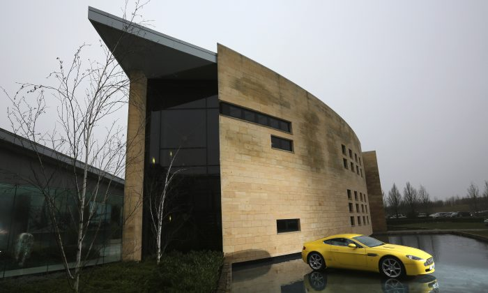 An Aston Martin motor car is displayed outside the company headquarters and production plant on Jan. 10, 2013 in Gaydon, England. (Christopher Furlong/Getty Images)