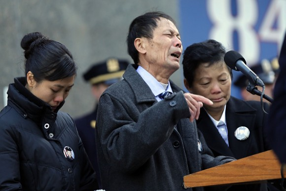 Wei Tang Liu (C), the father of Detective Wenjian Liu, speaks during a plaque dedication ceremony for two fallen New York Police Department  officers, Detective Rafael Ramos and his partner Detective Wenjian Liu at the 84th Precinct in Brooklyn on Dec. 20, 2015 in New York City. Detectives Ramos and Liu were fatally shot while sitting in their patrol car in Bedford-Stuyvesant one-year ago. The gunman, Ismaaiyl Brinsley, then killed himself.  (Spencer Platt/Getty Images)