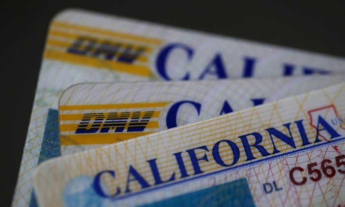 In this photo illustration, the California Department of Motor Vehicles (DMV) logo appears on a California driver license on May 9, 2017, in San Anselmo, Calif. (Justin Sullivan/Getty ImagesPhoto Illustration)
