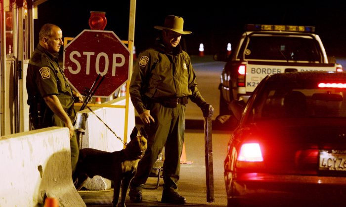 Customs and Border Patrol agents prepare to question a motorist at a checkpoint in Campo, California, in an undated file photo. (Sandy Huffaker/Getty Images)
