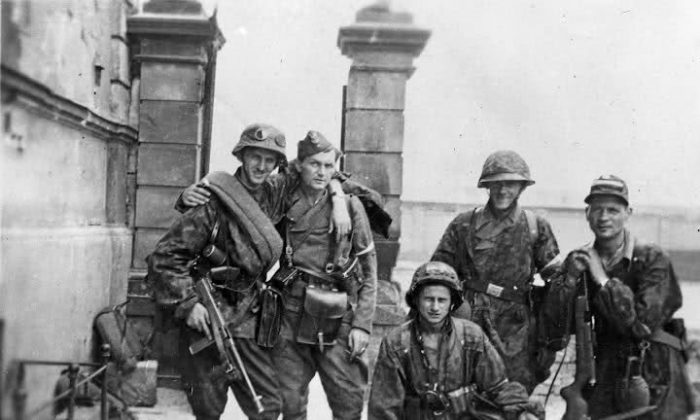 Members of the Armia Krojowa (Home Army) pose for a photo on Aug. 11, 1944, during the Warsaw Uprising. (Juliusz Bogdan Deczkowski/Public Domain)
