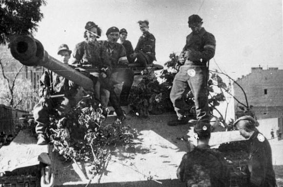 Soldiers of the Polish Home Army ride a captured German Panther tank on Aug. 2 1944, during the Warsaw Uprising. (Juliusz Bogdan Deczkowski/Public Domain)
