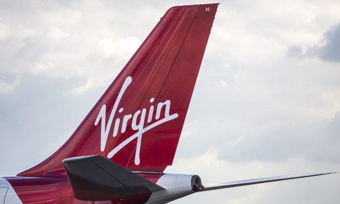 Virgin Airlines removes 11-year-old boy from his seat because they overbooked too many unaccompanied minors. (Photo by Jack Taylor/Getty Images)
