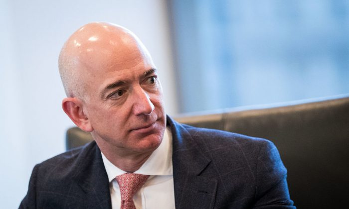Jeff Bezos, chief executive officer of Amazon, listens during a meeting of technology executives and President-elect Donald Trump at Trump Tower, December 14, 2016 in New York City. (Drew Angerer/Getty Images)