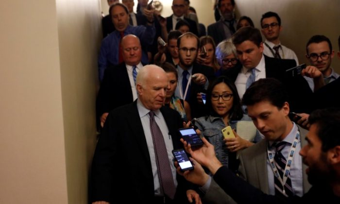 "Senator John McCain (R-AZ) speaks with reporters after voting against the ""skinny repeal"" health care bill on Capitol Hill in Washington on July 28, 2017. (REUTERS/Aaron P. Bernstein)"