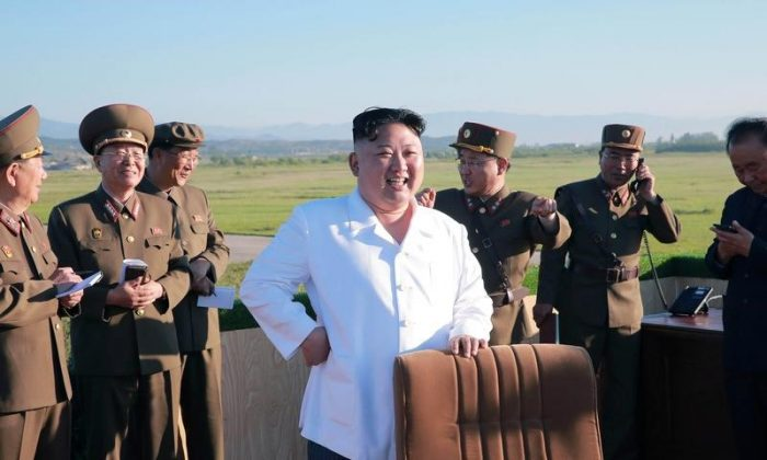 North Korean leader Kim Jong Un watches the test of a new-type anti-aircraft guided weapon system organized by the Academy of National Defence Science in this undated photo released by North Korea's Korean Central News Agency (KCNA) May 28, 2017. (KCNA/via REUTERS)
