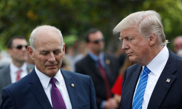 President Donald Trump stands with Secretary of Homeland Security John Kelly after laying flowers on the grave of Kelly's son, First Lieutenant Robert Kelly, at Arlington National Cemetery  in Arlington, Virginia on May 29, 2017. (Aaron P. Bernstein/Getty Images)