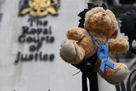 A picture shows a teddy bear set up by supporters of the family of British baby Charlie Gard outside the Royal Courts of Justice in London on July 24, 2017. (CHRIS J RATCLIFFE/AFP/Getty Images)