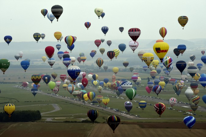 Hot air-balloons before the world record attempt of the biggest line with 456 balloons at the Mondial Air Ballons event at Chambley-Bussieres airbase, France, on July 28, 2017. (ALEXANDRE MARCHI/AFP/Getty Images)