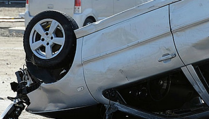 Overturned car. (MIKE CLARKE/AFP/Getty Images)