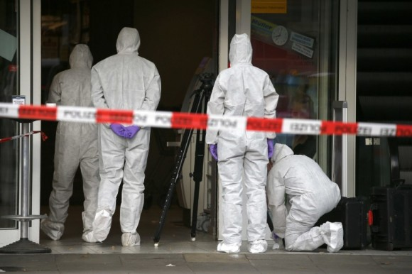 Police investigators work at the crime scene after a knife attack in a supermarket in Hamburg, Germany, July 28, 2017. (Reuters/Morris Mac Matzen)