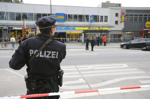 A police officer looks on after a knife attack in a supermarket in Hamburg, Germany, July 28, 2017.  (Reuters/Morris Mac Matzen)