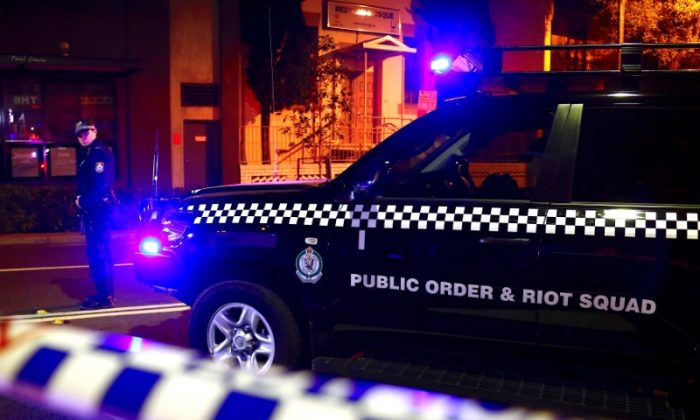 A policeman stands on a street that has been blocked to the public after Australian counter-terrorism police arrested four people in raids late on Saturday across several Sydney suburbs in Australia, July 29, 2017. (Reuters/David Gray)