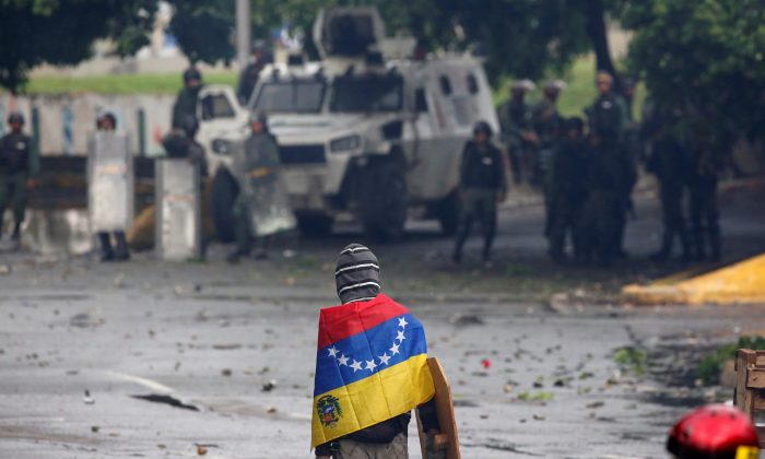 File photo: A demonstrator looks on while clashing with riot security forces during a rally against Venezuela's President Nicolas Maduro's government in Caracas, Venezuela, July 28, 2017. (Reuters/Carlos Garcia Rawlins)