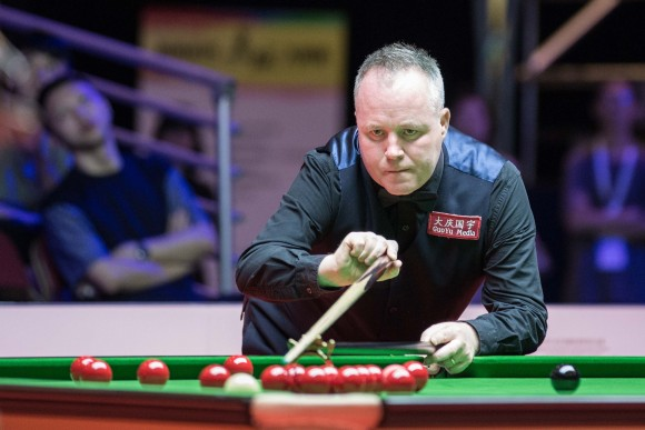 John Higgins playing in the quarter finals against Ronnie O'Sullivan, at the Queen Elizabeth Stadium, Hong Kong on Friday July 21. (Dan Marchant)