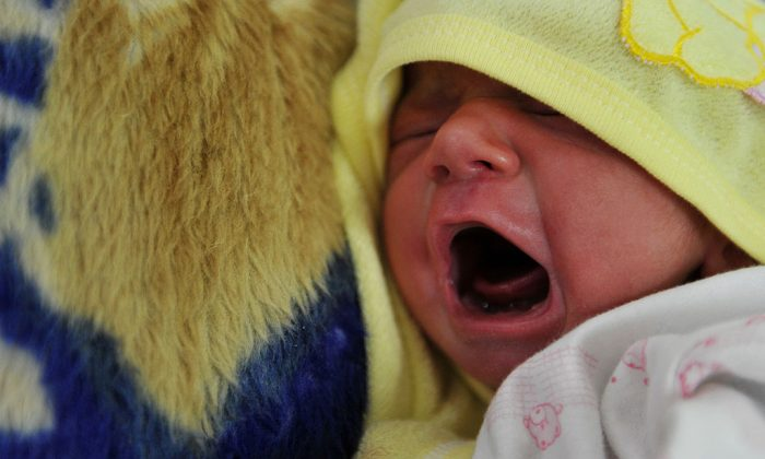 A newborn baby cries at a maternity ward (ADEK BERRY/AFP/Getty Images)