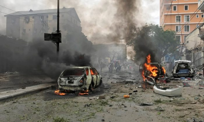 Vehicles burn at the scene of an explosion in Mogadishu, Somalia, July 30, 2017. (Reuters/Feisal Omar)