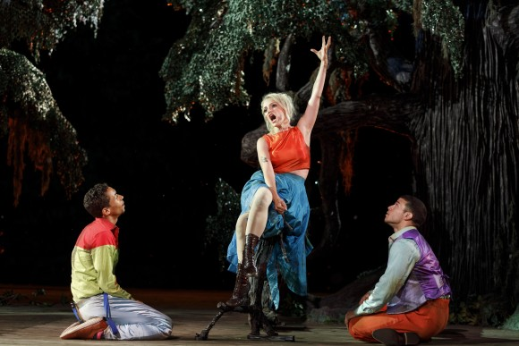 (L–R) A magical mistake causes both Lysander (Kyle Beltran) and Demetrius (R, Alex Hernandez) to fall in love with Helena (Annaleigh Ashford). (Joan Marcus)
