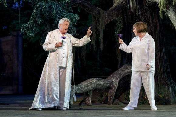Oberon, king of the fairies (Richard Poe), commands Puck (Kristine Nielsen) to use the magical juice from the flower to cast a spell on his wife Titania. (Joan Marcus)