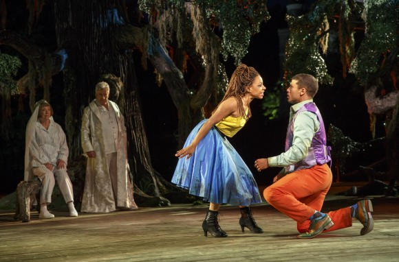 (L–R) The fairies (Kristine Nielsen and Richard Poe) watch the Hermia (Shalita Grant) and Demetrius (Alex Hernandez) in the forest. (Joan Marcus)