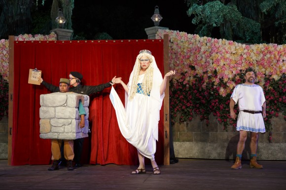"""(L–R) The working folk, as played by Patrina Murray, Robert Joy, Jeff Hiller, and Danny Burstein, put on their rendition of the play """"The most Lamentable Comedy and Cruel Death of Pyramus and Thisbe"""" to celebrate the nuptials of the duke. (Joan Marcus)"""