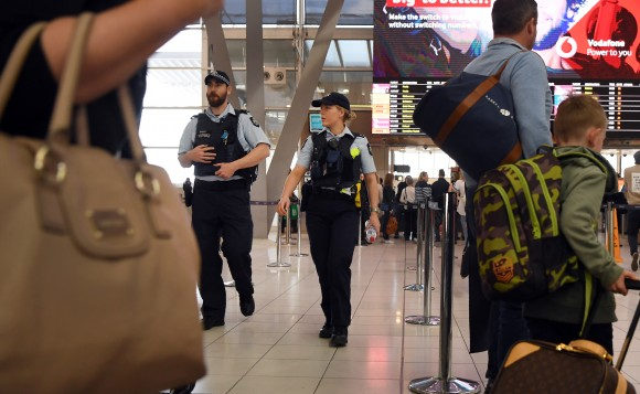 Police walk past passengers as they patrol Sydney Airport on July 30, 2017. (WILLIAM WEST/AFP/Getty Images)