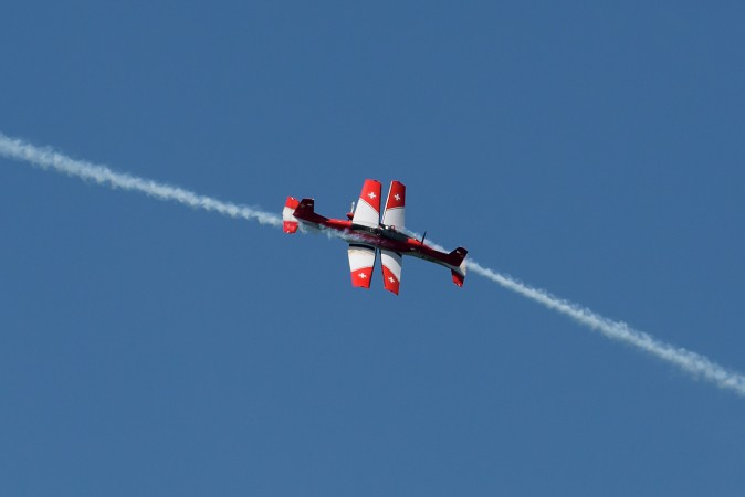 PC-7 Pilatus planes of the Swiss Air Force Aerobatics Team cross during a flight display prior to the final of the Swiss Open ATP 250 tennis tournament in Gstaad on July 30, 2017. (FABRICE COFFRINI/AFP/Getty Images)